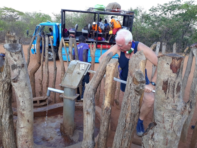 Cecil pumping water. He installed these 30 years ago in Kenya.